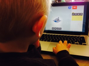 My then 5 year-old coding with Lightbot.